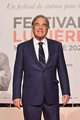 <span style='display:inline-block; background-color:#DF071E; width: 100%;padding:5px;'>Oliver Stone</span>
